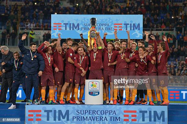 Roma team celebrates the victory with the trophy after the Primavera Supercup match between AS Roma and FC Internazionale at Olimpico Stadium on...