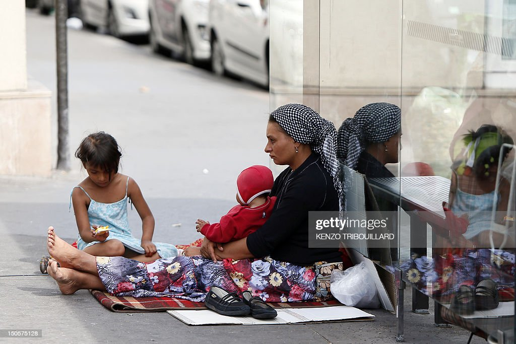 A Roma woman and her children begs place de la Bastille in Paris, on August 22, 2012. The French government seeks to end a row over its treatment of ethnic Roma migrants in a move that could result in Bulgarian and Romanian citizens being granted the right to work in France.