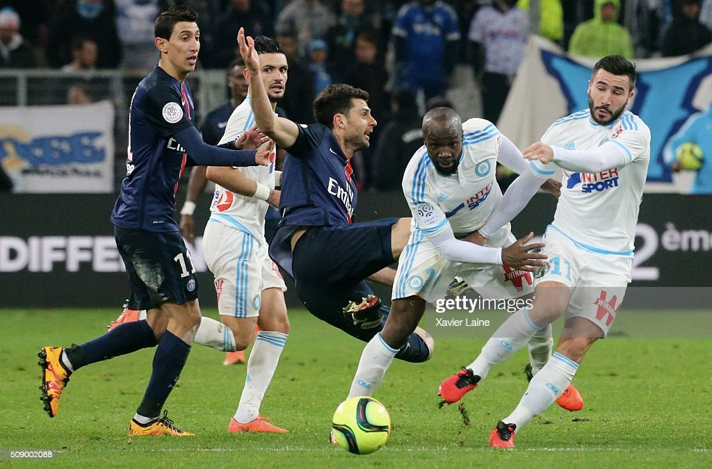 <a gi-track='captionPersonalityLinkClicked' href=/galleries/search?phrase=Romain+Alessandrini&family=editorial&specificpeople=9572619 ng-click='$event.stopPropagation()'>Romain Alessandrini</a> #11, <a gi-track='captionPersonalityLinkClicked' href=/galleries/search?phrase=Lassana+Diarra&family=editorial&specificpeople=607251 ng-click='$event.stopPropagation()'>Lassana Diarra</a> #10 and Remy Cabella #13 of Olympique de Marseille slash <a gi-track='captionPersonalityLinkClicked' href=/galleries/search?phrase=Thiago+Motta+-+Brazilian+Soccer+Player+-+Born+1982&family=editorial&specificpeople=631059 ng-click='$event.stopPropagation()'>Thiago Motta</a> #8 of Paris Saint-Germain and <a gi-track='captionPersonalityLinkClicked' href=/galleries/search?phrase=Angel+Di+Maria&family=editorial&specificpeople=4110691 ng-click='$event.stopPropagation()'>Angel Di Maria</a> ##11 reacts during the French Ligue 1 between Olympique de Marseille and Paris Saint-Germain at Stade Velodrome on february 7, 2016 in Marseille, France.