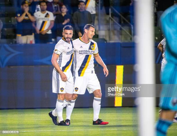 Romain Alessandrini of Los Angeles Galaxy celebrates his goal with Daniel Steres of Los Angeles Galaxy during Los Angeles Galaxy's MLS match against...