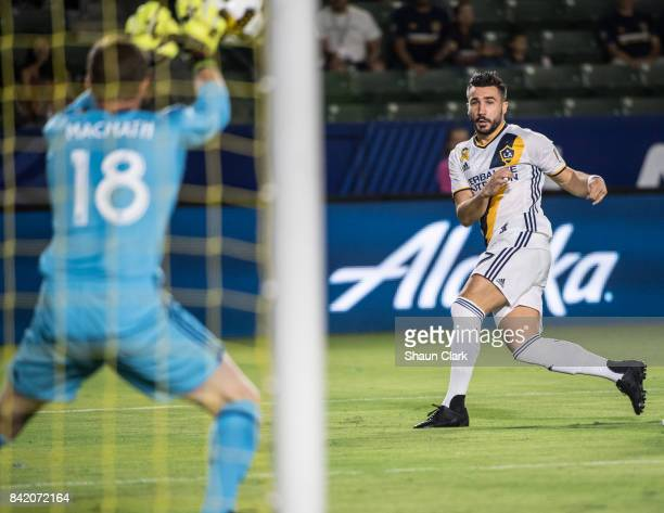 Romain Alessandrini of Los Angeles Galaxy takes a shot on goal during the Los Angeles Galaxy's MLS match against Colorado Rapids at the StubHub...