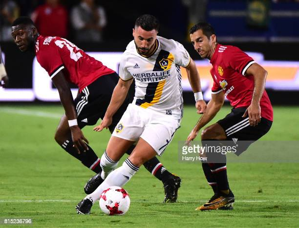 Romain Alessandrini of Los Angeles Galaxy turns from Timothy FosuMensah and Henrikh Mkhitaryan of Manchester United during a 52 United victory at...