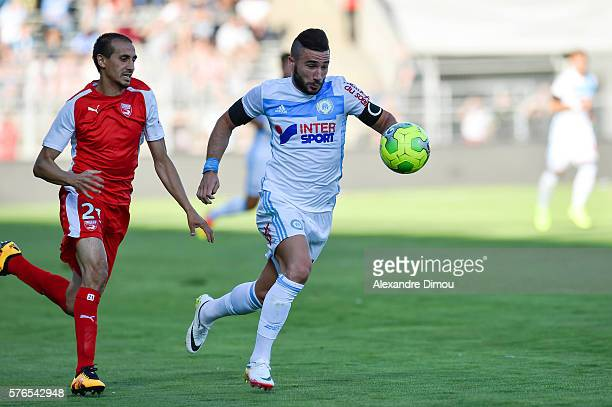 Romain Alessandrini of Marseille and Fethi Harek of Nimes during the pre season friendly match between Nimes and Olympique de Marseille on July 15...