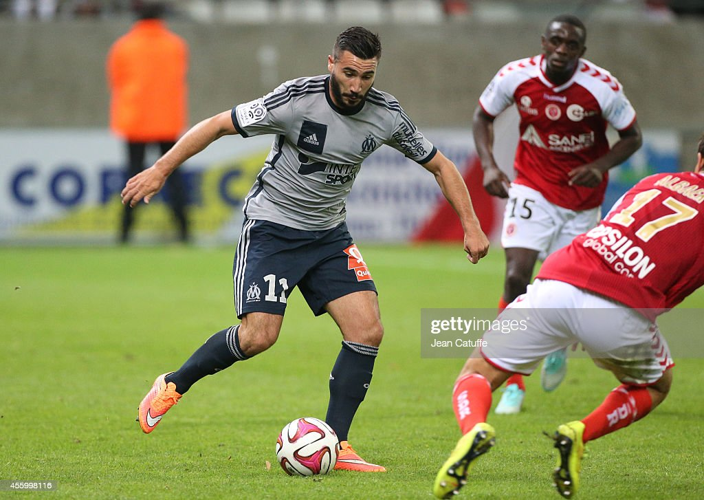 <a gi-track='captionPersonalityLinkClicked' href=/galleries/search?phrase=Romain+Alessandrini&family=editorial&specificpeople=9572619 ng-click='$event.stopPropagation()'>Romain Alessandrini</a> of OM in action during the French Ligue 1 match between Stade de Reims and Olympique de Marseille OM at the Stade Auguste Delaune on September 23, 2014 in Reims, France.