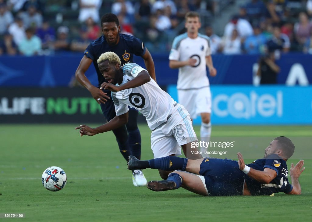 Romain Alessandrini #7 of the Los Angele Galaxy tackles Kevin Molino #18 of Minnesota United FC in the first half during the MLS game at StubHub Center on October 15, 2017 in Carson, California.