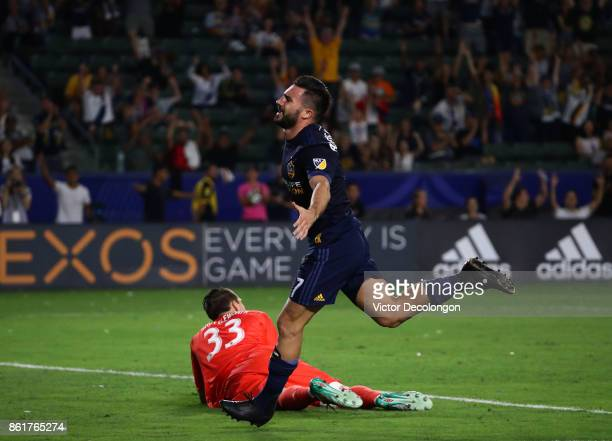 Romain Alessandrini of the Los Angeles Galaxy celebrates after scoring a goal against goaltender Bobby Shuttleworth of Minnesota United FC in the...