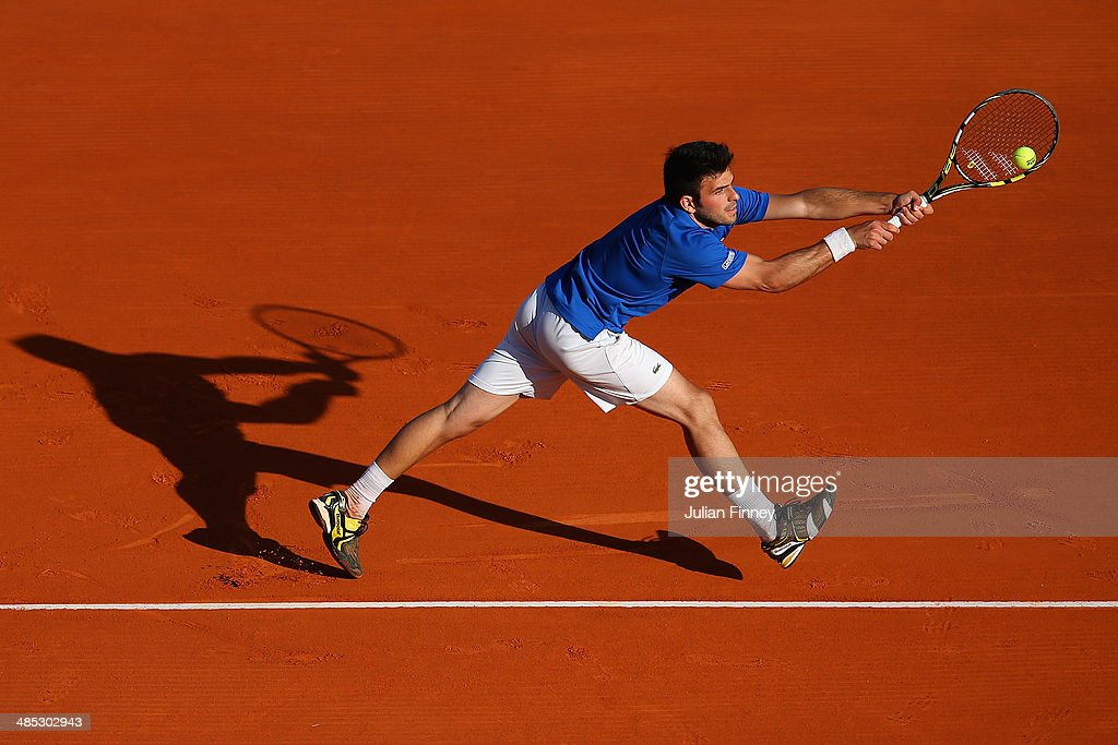 Romain Arneodo plays a backhand with partner (out of frame) Benjamin Balleret of Monaco in their doubles match against Andreas Seppi of Italy and Roberto Bautista Agut of Spain during day five of the ATP Monte Carlo Rolex Masters Tennis at Monte-Carlo Sporting Club on April 17, 2014 in Monte-Carlo, Monaco.