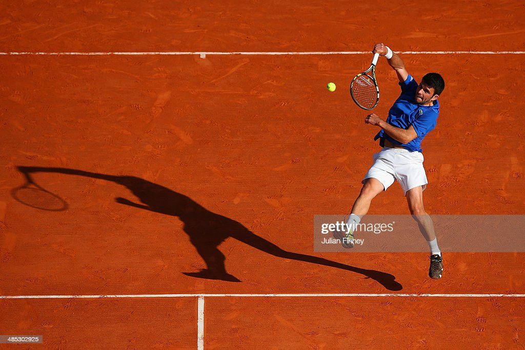 Romain Arneodo plays a smash with partner (out of frame) Benjamin Balleret of Monaco in their doubles match against Andreas Seppi of Italy and Roberto Bautista Agut of Spain during day five of the ATP Monte Carlo Rolex Masters Tennis at Monte-Carlo Sporting Club on April 17, 2014 in Monte-Carlo, Monaco.