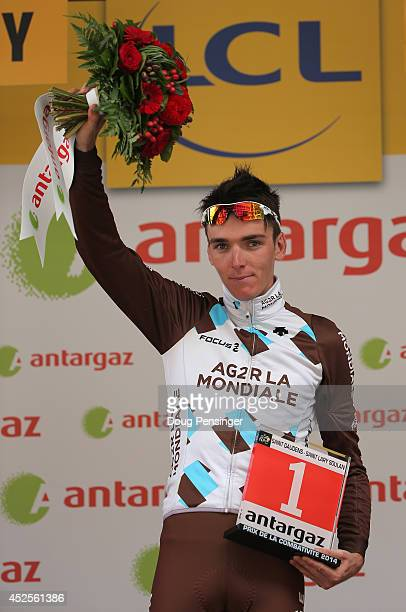 Romain Bardet of France and AG2R La Mondiale takes the podium after being named the most aggressive rider in the seventeenth stage of the 2014 Tour...