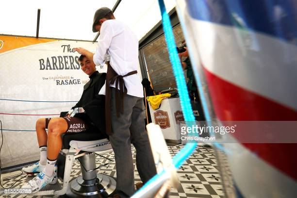 Romain Bardet of France riding for AG2R La Mondiale gets a haircut in the start village prior to stage 15 of the 2017 Le Tour de France a 1895km...