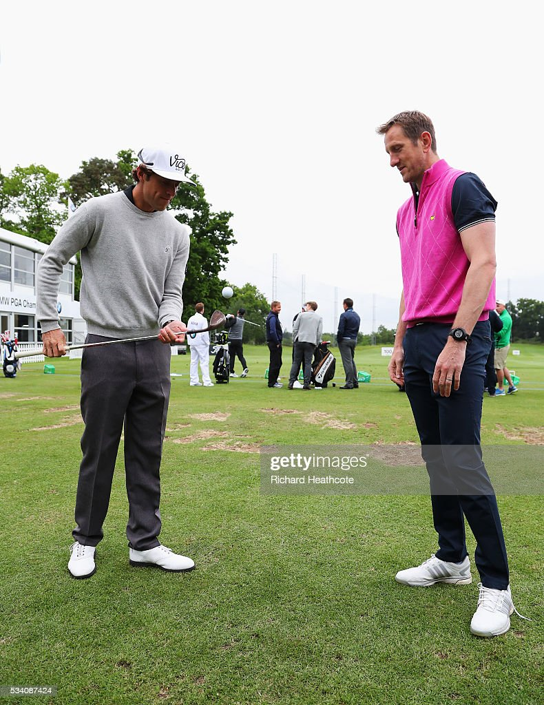 Romain Bechu plays a trick shot watched by former Rugby Union player Will Greenwood during the Pro-Am prior to the BMW PGA Championship at Wentworth on May 25, 2016 in Virginia Water, England.