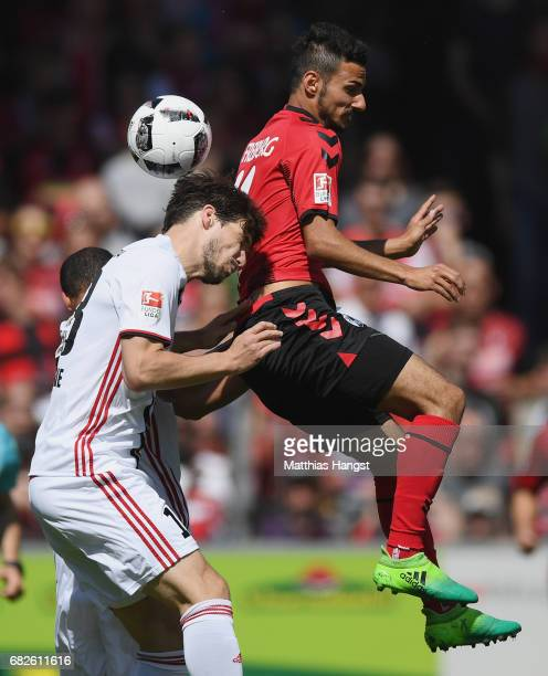 Romain Bregerie of Ingolstadt jumps for a header with Onur Bulut of Freiburg during the Bundesliga match between SC Freiburg and FC Ingolstadt 04 at...