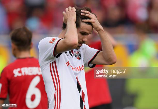 Romain Bregerie of Ingolstadt shows his disappointment after the Bundesliga match between SC Freiburg and FC Ingolstadt 04 at SchwarzwaldStadion on...