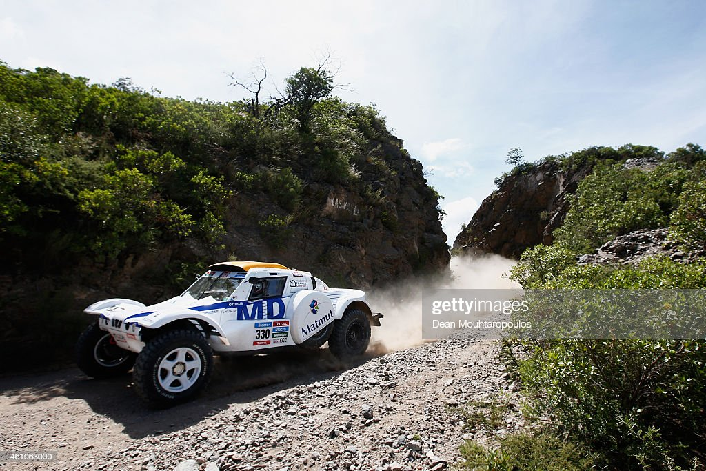 <a gi-track='captionPersonalityLinkClicked' href=/galleries/search?phrase=Romain+Dumas&family=editorial&specificpeople=805197 ng-click='$event.stopPropagation()'>Romain Dumas</a> and Francois Borsotto of France for MD Rallye Sport in the Optimus MD Buggy compete during day 2 of the Dakar Rallly on January 5, 2015 between Villa Carlos Paz and San Juan near the town of Taninga, Argentina.