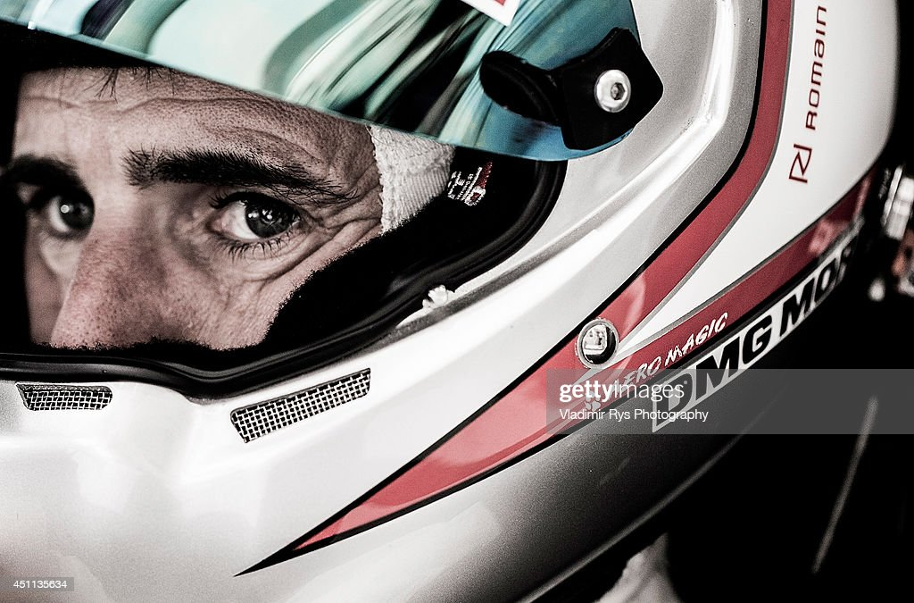 <a gi-track='captionPersonalityLinkClicked' href=/galleries/search?phrase=Romain+Dumas&family=editorial&specificpeople=805197 ng-click='$event.stopPropagation()'>Romain Dumas</a> of France and Porsche 919 Hybrid sits in his car during the Le Mans 24 Hour Race at Circuit de la Sarthe on June 15, 2014 in Le Mans, France.