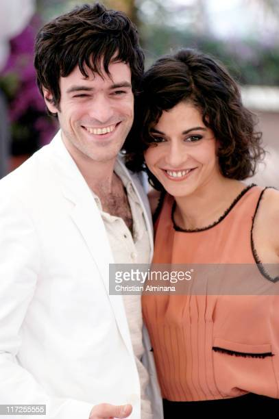 Romain Duris and Lubna Azabal during 2004 Cannes Film Festival Exils Photocall at Palais Du Festival in Cannes France