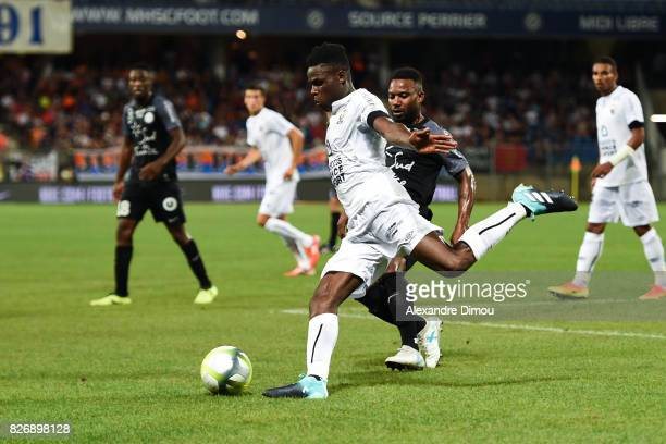 Romain Genevois of Caen and Stephane Sessegnon of Montpellier during the Ligue 1 match between Montpellier Herault SC and SM Caen at Stade de la...