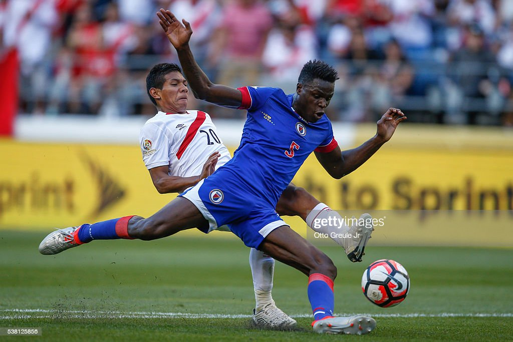Romain Genevois #5 of Haiti battles <a gi-track='captionPersonalityLinkClicked' href=/galleries/search?phrase=Edison+Flores&family=editorial&specificpeople=8597891 ng-click='$event.stopPropagation()'>Edison Flores</a> #20 of Peru during the Copa America Centenario Group B match at CenturyLink Field on June 4, 2016 in Seattle, Washington.