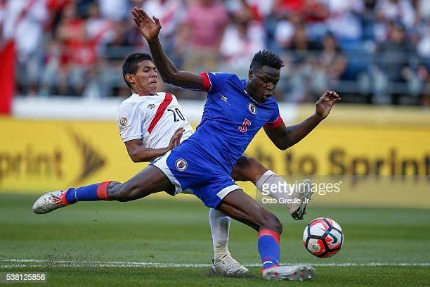 Romain Genevois of Haiti battles Edison Flores of Peru during the Copa America Centenario Group B match at CenturyLink Field on June 4 2016 in...