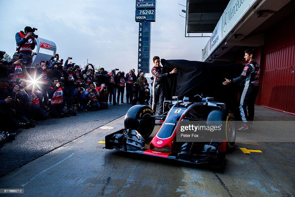 <a gi-track='captionPersonalityLinkClicked' href=/galleries/search?phrase=Romain+Grosjean&family=editorial&specificpeople=4858519 ng-click='$event.stopPropagation()'>Romain Grosjean</a> of France and Haas F1 and Esteban Gutierrez of Mexico and Haas F1 unveil the new ocar outsied the garage during day one of F1 winter testing at Circuit de Catalunya on February 22, 2016 in Montmelo, Spain.