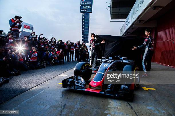 Romain Grosjean of France and Haas F1 and Esteban Gutierrez of Mexico and Haas F1 unveil the new ocar outsied the garage during day one of F1 winter...
