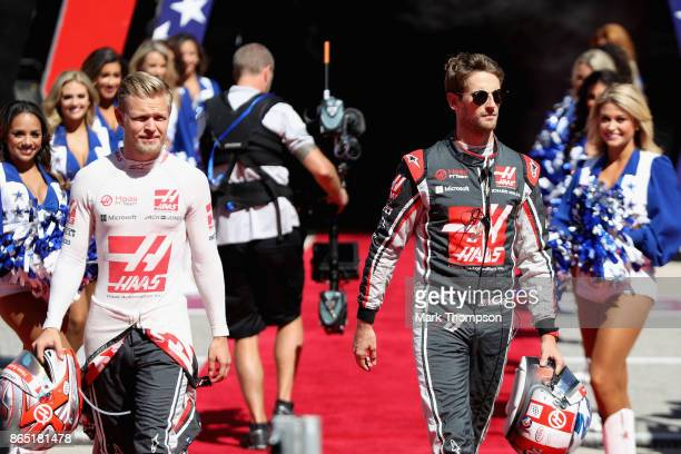 Romain Grosjean of France and Haas F1 and Kevin Magnussen of Denmark and Haas F1 walk to the grid before the United States Formula One Grand Prix at...