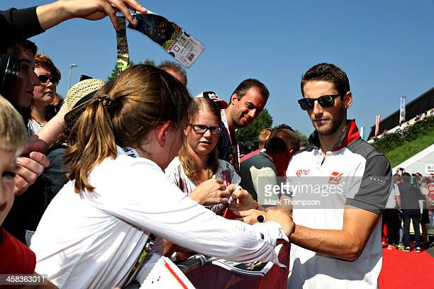 Romain Grosjean of France and Haas F1 signs autographs for fans before final practice for the Formula One Grand Prix of Austria at Red Bull Ring on...