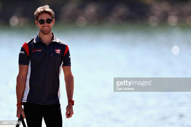 Romain Grosjean of France and Haas F1 walks into the paddock during previews for the Canadian Formula One Grand Prix at Circuit Gilles Villeneuve on...