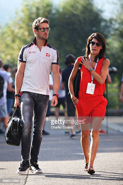 Romain Grosjean of France and Haas F1 walks with wife Marion Jollès Grosjean in the Paddock before final practice for the Formula One Grand Prix of...