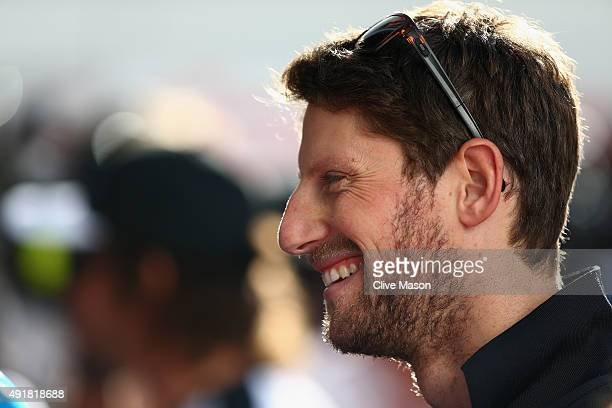Romain Grosjean of France and Lotus speaks with members of the media in the paddock during previews to the Formula One Grand Prix of Russia at Sochi...