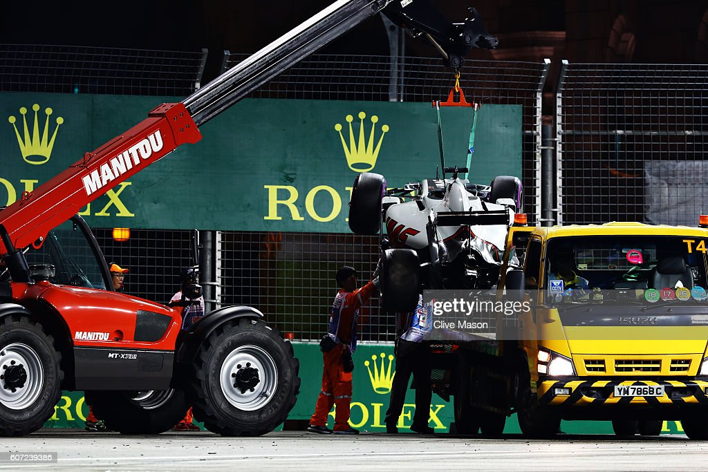 Romain Grosjean of France driving the (8) Haas F1 Team Haas-Ferrari VF-16 Ferrari 059/5 turbo is removed from the circuit during qualifying for the Formula One Grand Prix of Singapore at Marina Bay Street Circuit on September 17, 2016 in Singapore.