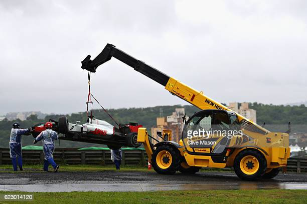 Romain Grosjean of France driving the Haas F1 Team HaasFerrari VF16 Ferrari 059/5 turbo is removed from the circuit after crashing on the parade lap...