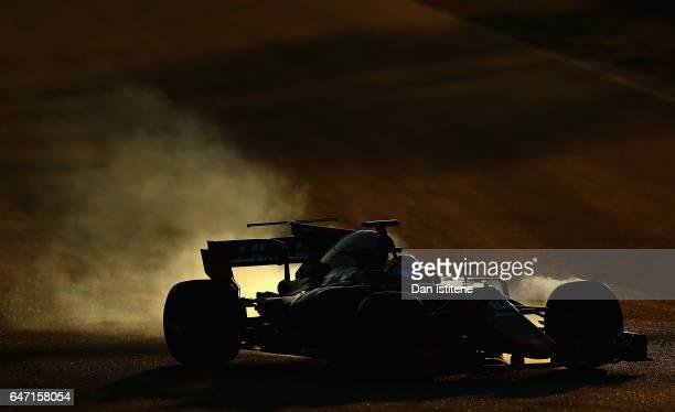 Romain Grosjean of France driving the Haas F1 Team HaasFerrari VF17 Ferrari locks a wheel under braking on track during day four of Formula One...