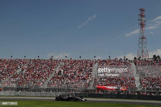 Romain Grosjean of France driving the Haas F1 Team HaasFerrari VF17 Ferrari on track during the Canadian Formula One Grand Prix at Circuit Gilles...