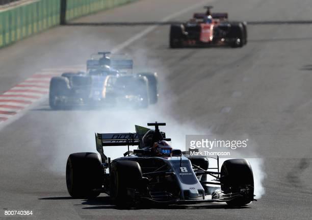 Romain Grosjean of France driving the Haas F1 Team HaasFerrari VF17 Ferrari locks a wheel under braking during the Azerbaijan Formula One Grand Prix...