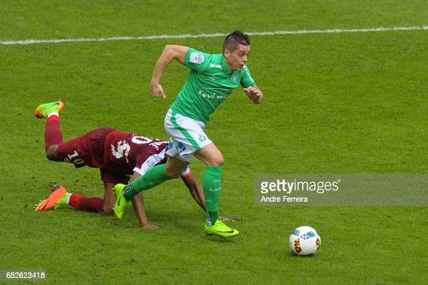 Romain Hamouma of Saint Etienne and Cheick Doukoure of Metz during the French Ligue 1 match between Saint Etienne and Metz at Stade GeoffroyGuichard...