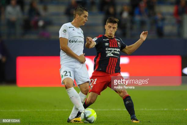 Romain Hamouma of Saint Etienne and Frederic Guilbert of Caen during the Ligue 1 match between SM Caen and AS Saint Etienne at Stade Michel D'Ornano...
