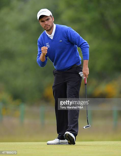 Romain Langasque of France celebrates sinking his putt on the 8th green to win the hole during the Final of The Amateur Championship 2015 Day Six at...