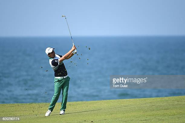 Romain Langasque of France hits an approach shot on the 9th hole during day one of the NBO Golf Classic Grand Final at Al Mouj Golf on November 2...