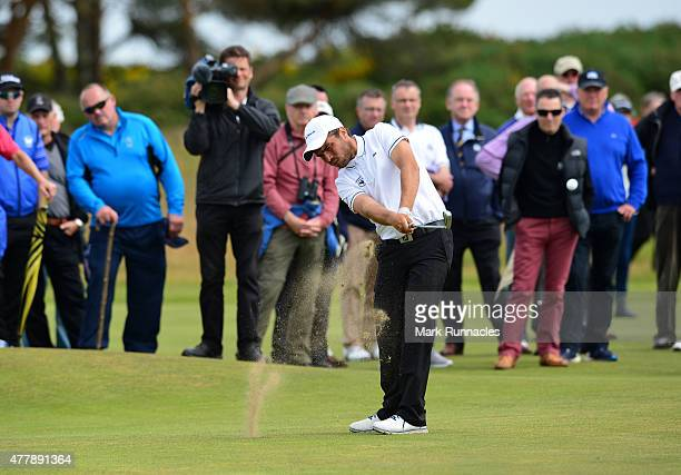Romain Langasque of France plays his approach shot to the 13th during day Six of the Amateur Championship 2015 at Carnoustie Golf Links on June 20...