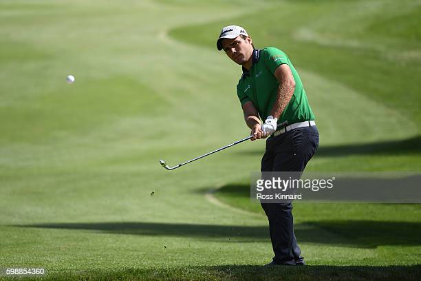 Romain Langasque of France plays his third shot on the first hole during the third round of the Omega European Masters at CranssurSierre Golf Club on...