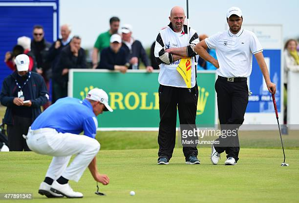 Romain Langasque of France watches Grant Forrest lining up a putt during day Six of the Amateur Championship 2015 at Carnoustie Golf Links on June 20...