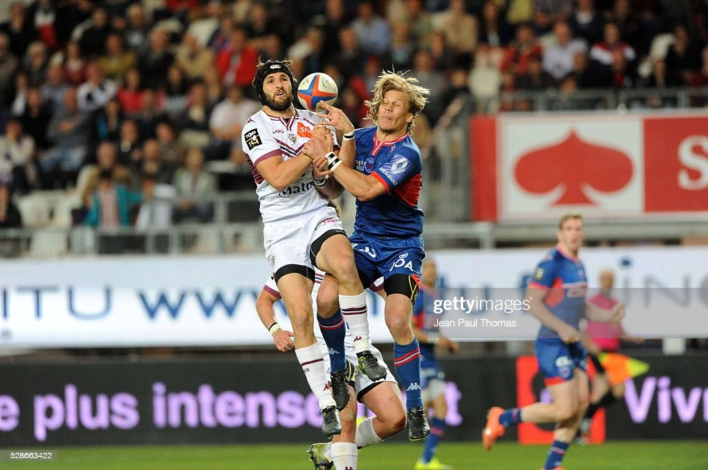 Romain Lonca of Bordeaux Begles and Charl McLeod of Grenoble during the French Top 14 rugby union match between Grenoble and Union Bordeaux-Begles at Stade des Alpes on May 6, 2016 in Grenoble, France.
