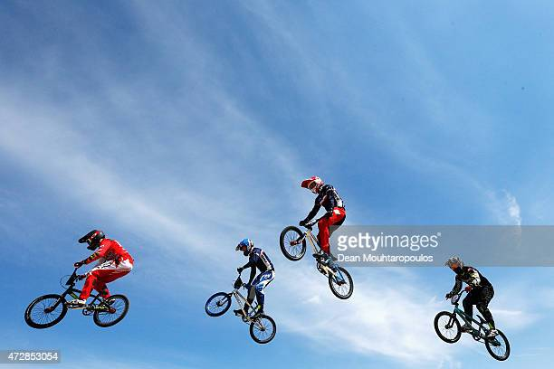 Romain Mahieu and Sylvain Andre of France Dave van der Burg of the Netherlands and Yvan Lapraz of Switzerland compete in Heat 2 of the Mens Elite UCI...