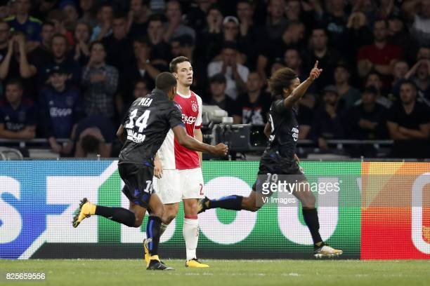 Romain Perraud of OCG Nice Nick Viergever of Ajax Vincent Marcel of OCG Nice during the UEFA Champions League third round qualifying first leg match...