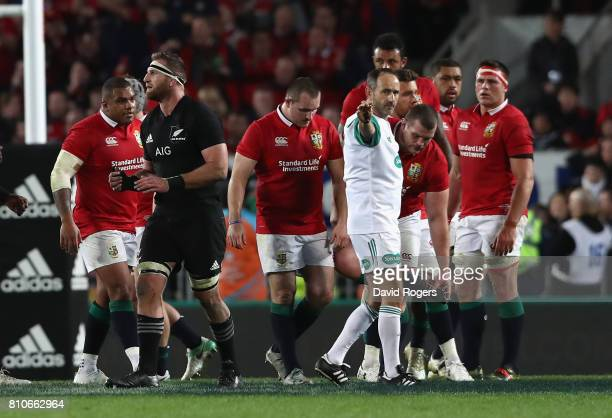 Romain Poite the referee reverses a decision when he award a penalty to the All Blacks with only two minutes to go during the Test match between the...