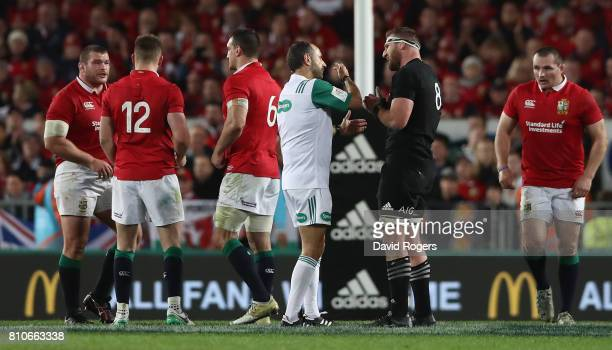 Romain Poite the referee talks to All Black captain Kieran Read after he reverses a decision when he awarded a penalty to the All Blacks with only...