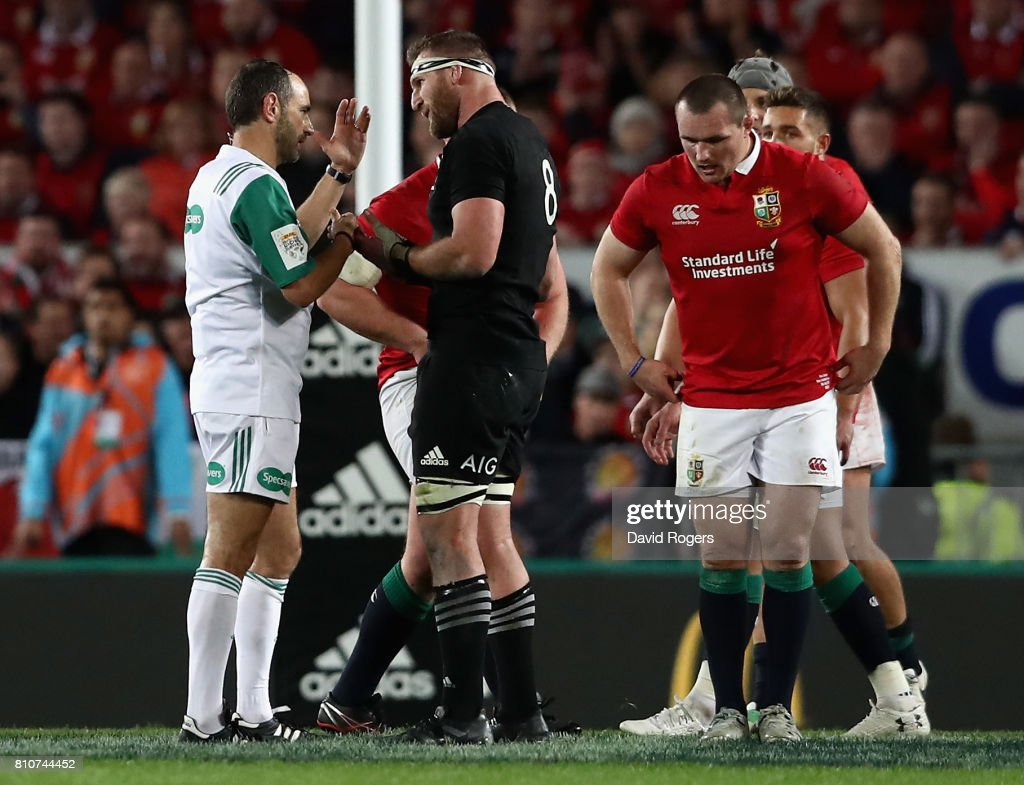 Romain Poite the referee, talks to All Black captain, Kieran Read after he reverses a decision when he orginally had awarded a penalty to the All Blacks with only two minutes to go during the Test match between the New Zealand All Blacks and the British & Irish Lions at Eden Park on July 8, 2017 in Auckland, New Zealand.