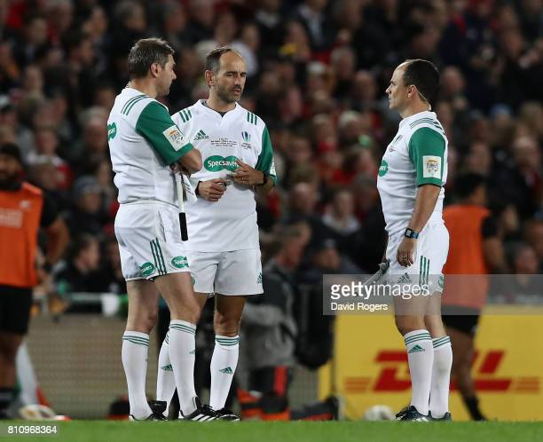 Romain Poite the referee talks to his assistants Jerome Garces and Jaco Peyper during the Test match between the New Zealand All Blacks and the...