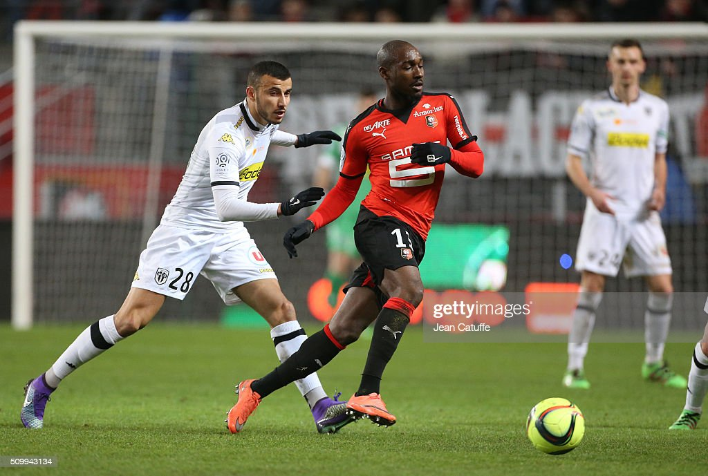 Romain Saiss of Angers and <a gi-track='captionPersonalityLinkClicked' href=/galleries/search?phrase=Giovanni+Sio&family=editorial&specificpeople=7023343 ng-click='$event.stopPropagation()'>Giovanni Sio</a> of Rennes in action during the French Ligue 1 match between Stade Rennais FC (Rennes) and SCO Angers at Roazhon Park stadium on February 12, 2016 in Rennes, France.